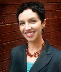 woman with short black hair in blazer
