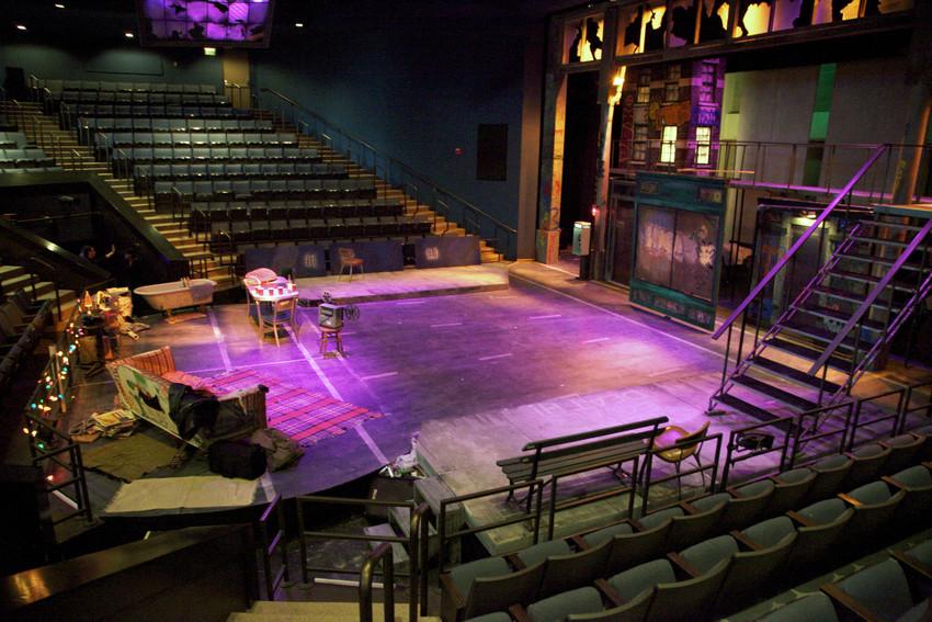 image of stage set with purple lighting