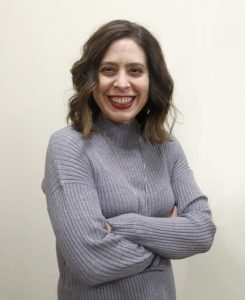 woman in grey turtleneck